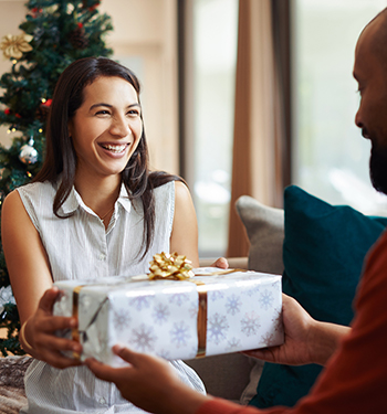 woman receiving a gift at the holidays